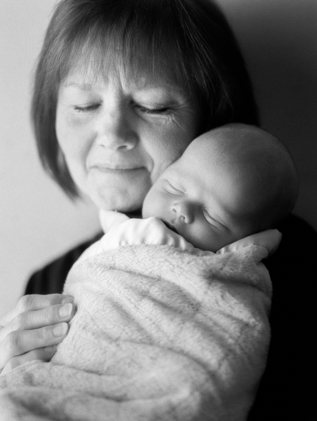 grandmother holding grandson