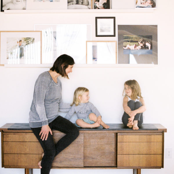 mother sitting with children on credenza