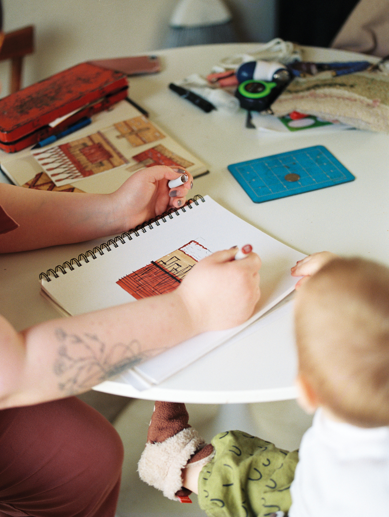 mother drawing with son