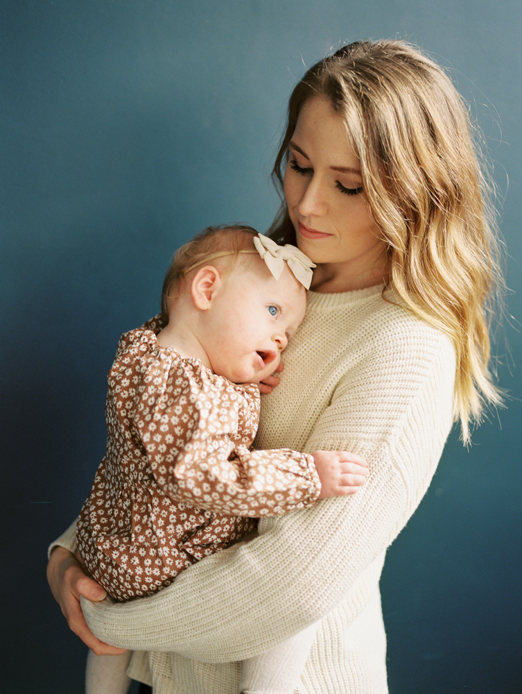 mother holding daughter