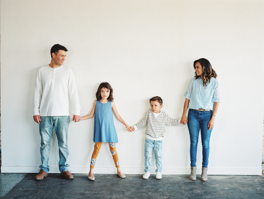 family standing together holding hands